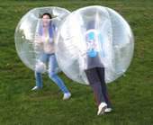 Two girls having a BodyZorbing duel