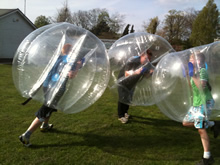 Three people bumping each other in BodyZorbs