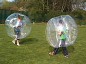 Two boys about to run into each other in the BodyZorbs