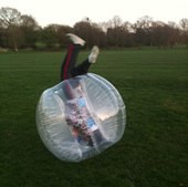 A boy rolling over in a BodyZorb