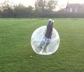 A boy upside down in a BodyZorb